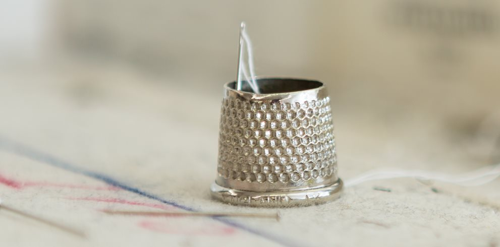 Thimble with Needle and Thread