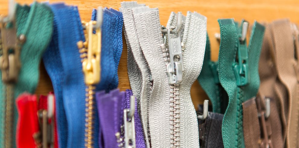 Replacement Zippers Hanging on Hooks from Zipper Sliders