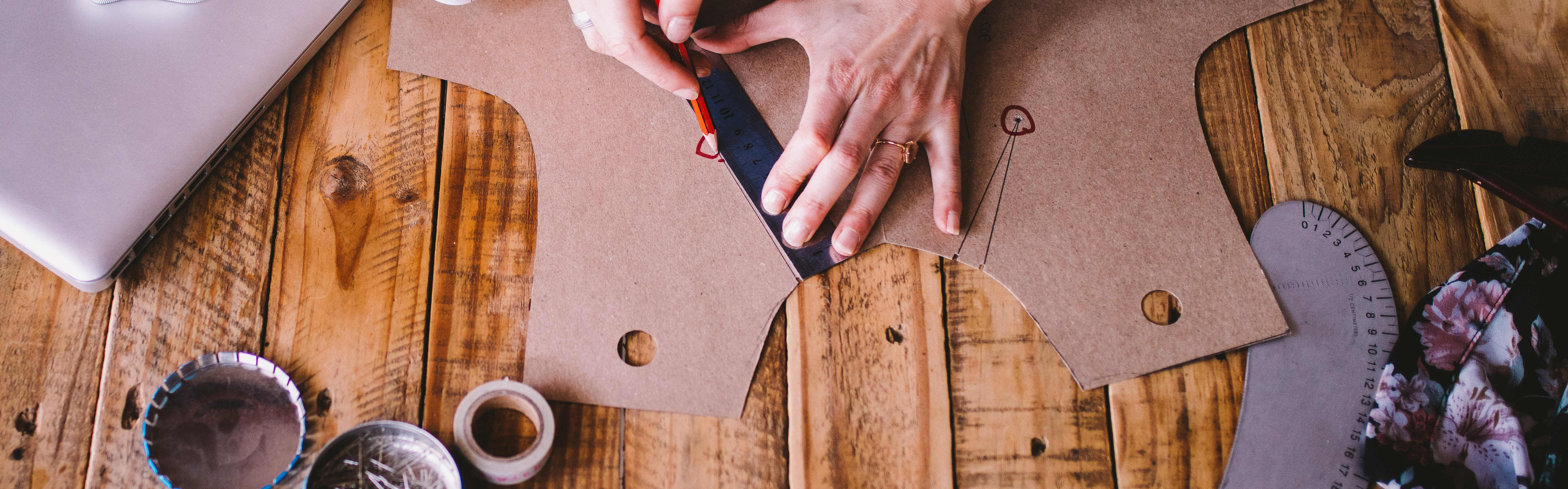 Hands Pattern Making Marking Tools on Wooden Table